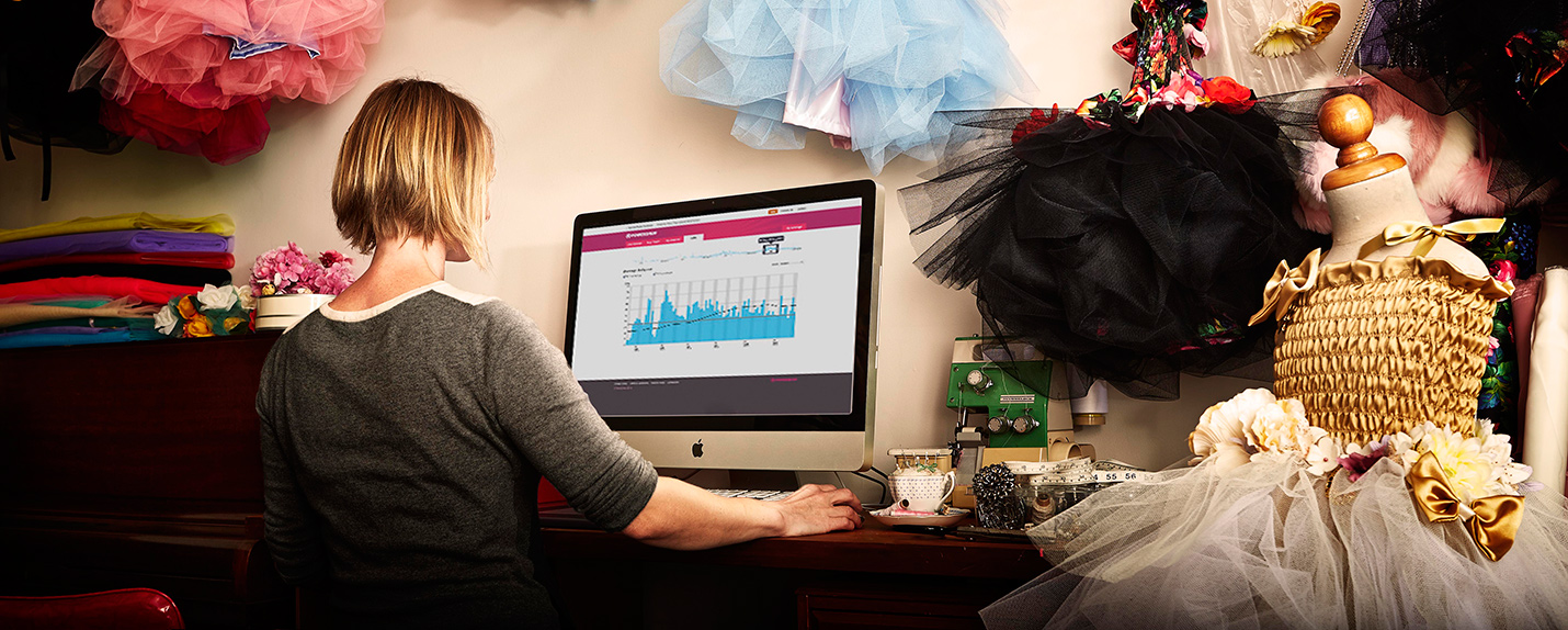 Photo of small business owner sitting at their computer checking their energy usage with Powershop